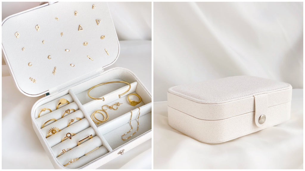 White jewelry case shown with dainty gold jewelry made by Katie Dean Jewelry in California.