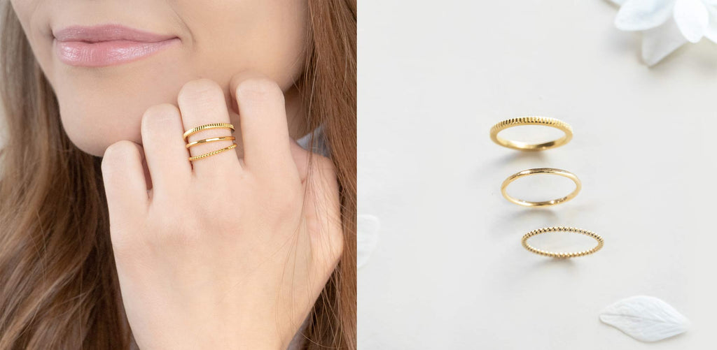 The Katie Dean Jewelry ring sets with a brunette model wearing the minimal stack.