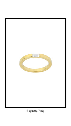 Baguette Ring in gold plating with clear baguette Swarovski crystal against white background.