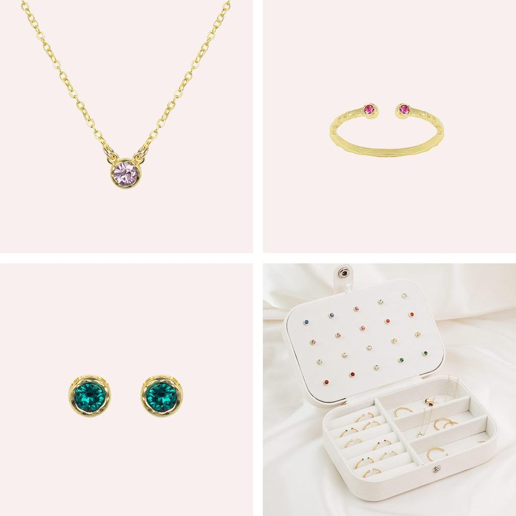 Image showing the Birthstone Gift Set and what it includes, one Birthstone Necklace, Ring and pair of earrings as well as a white jewelry case to store and organize your jewelry in. The Jewelry case is perfect for travel too.