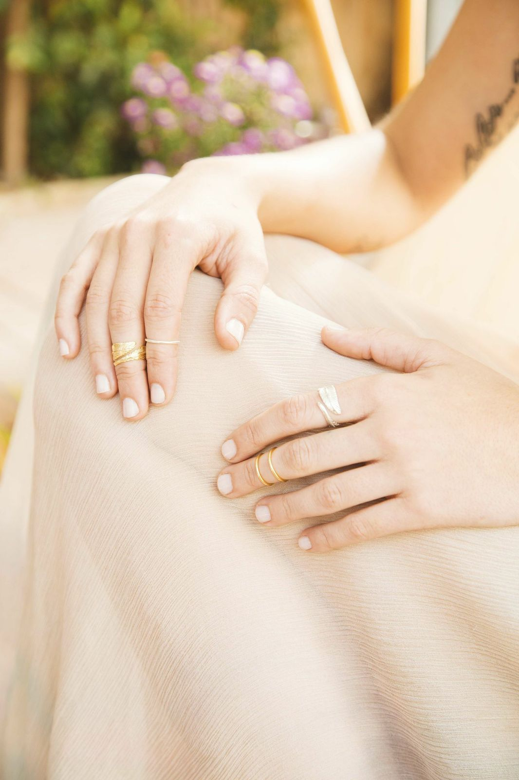 Image of models hands while wearing the gold Feather Ring.