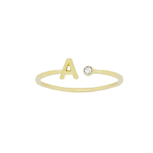Up close image of the gold Initial Ring with one crystal.