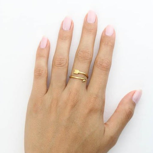 Image of models hand wearing the gold Wrap Arrow Ring.