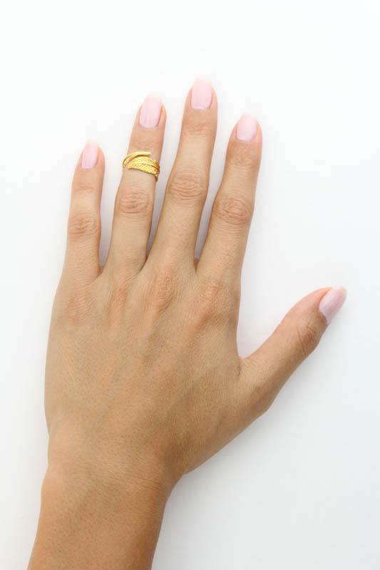 Image of models hand wearing the gold Feather Ring.
