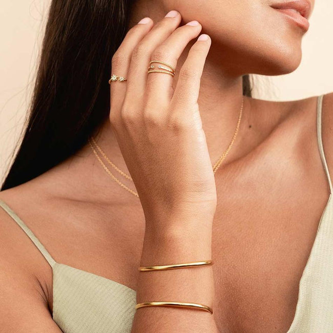 The Claw Cuff as seen on a model. It's perfect for the minimalist who wants to make a statement. Handmade in California by Katie Dean Jewelry.