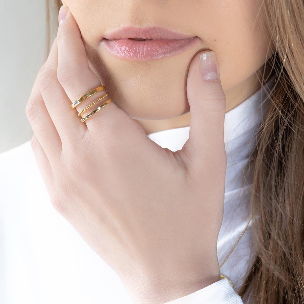 Classic, golden, timeless. We love the Golden Ring Stack stack for its dainty sparkle. This stack includes: Baguette Ring, Beaded Ring, Three Gem Ring