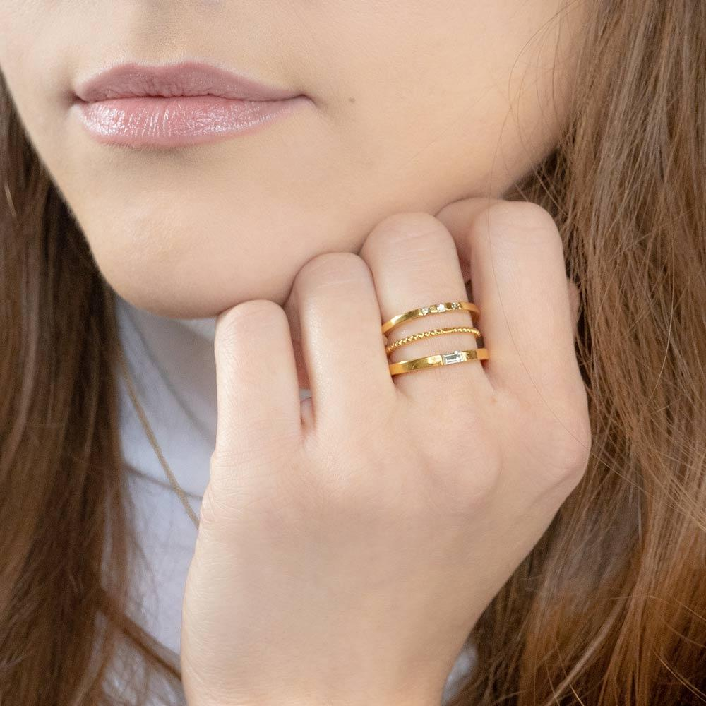 Up close image of Katie Dean model wearing the Golden Stack.
