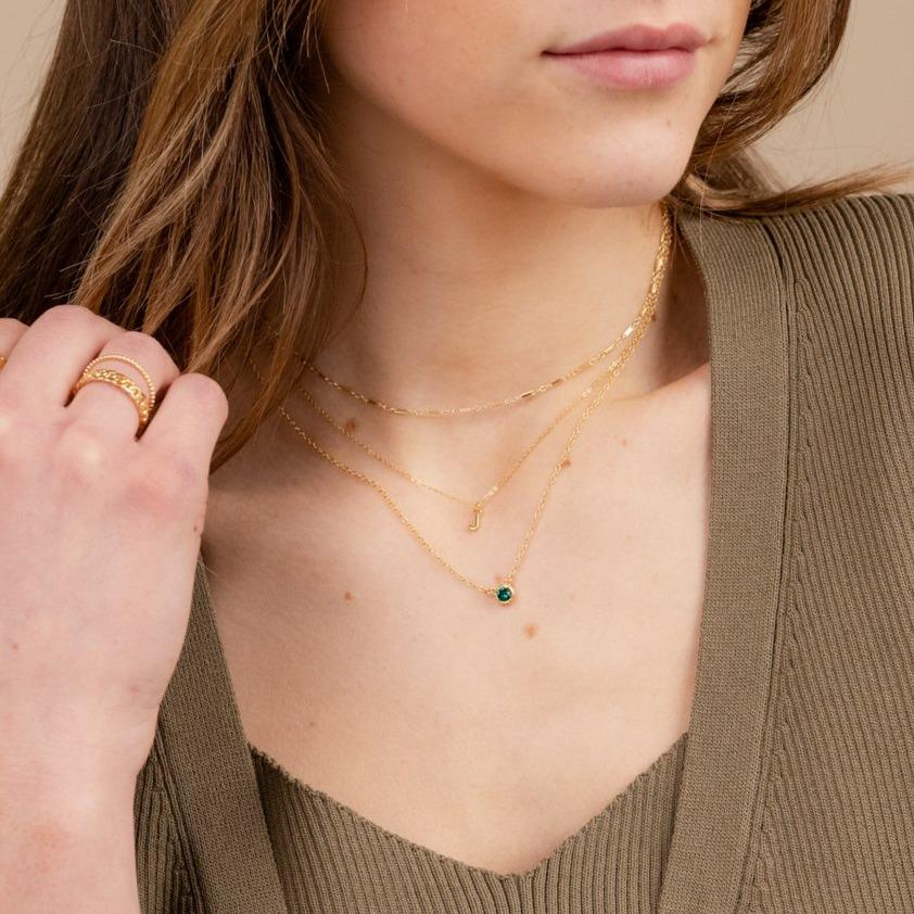 Model wearing the dainty gold Birthstone Necklace, Linked Choker, Initial Necklace, handmade in America by Katie Dean Jewelry