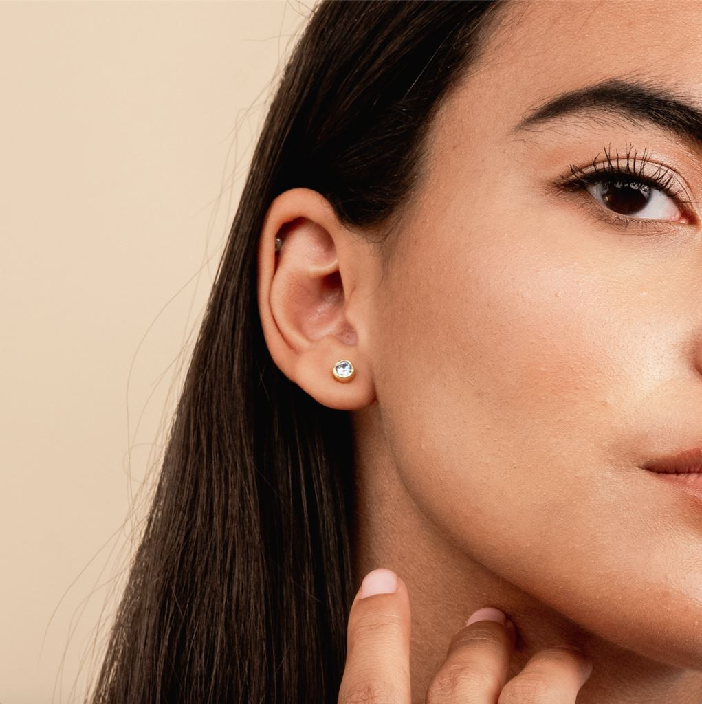 Dainty Birthstone Stud Earrings shown on model, handmade in California by Katie Dean Jewelry. Nickel Free and hypoallergenic.