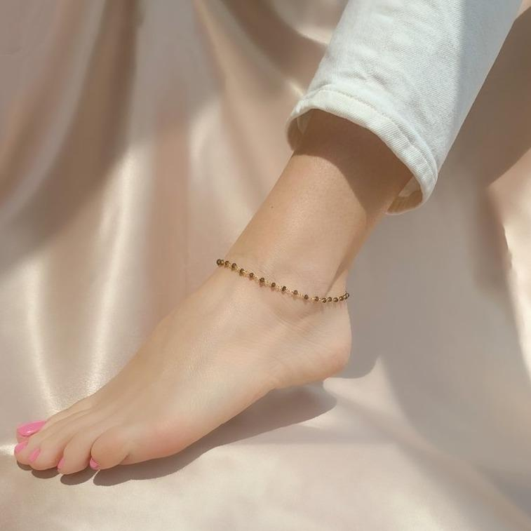 The Boho Anklet is dainty with a bohemian vibe. Detailed with dark purple stone beads that make it a little more bold.