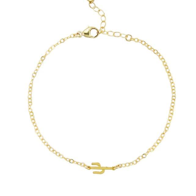 Up close image of gold Cactus Bracelet chain with a tiny cactus pendant against a white background.