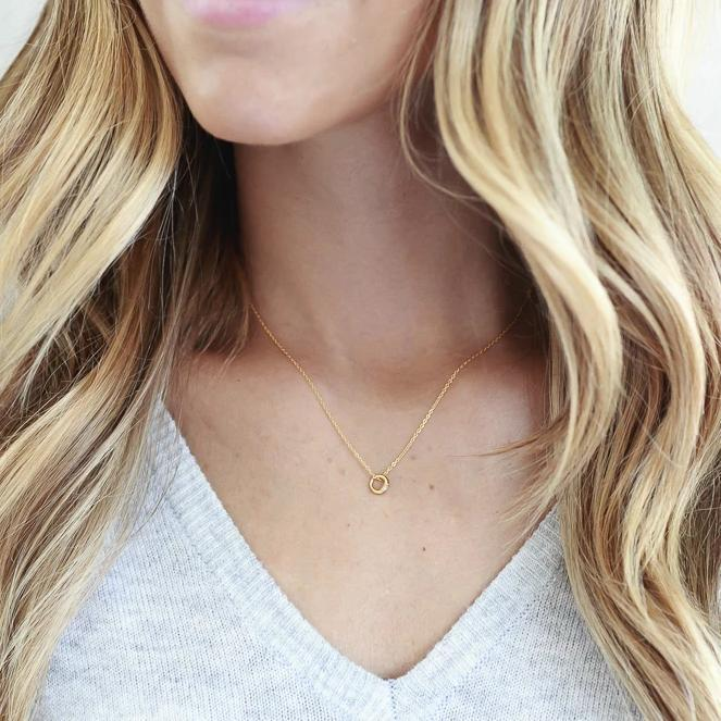 Image of model wearing the gold Circle Necklace.