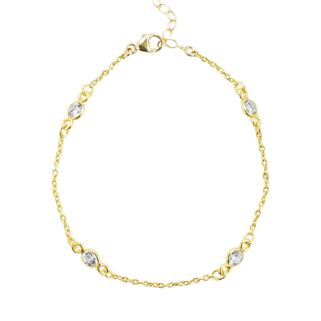 Up close image of gold Crystal Chain Bracelet against a white background.