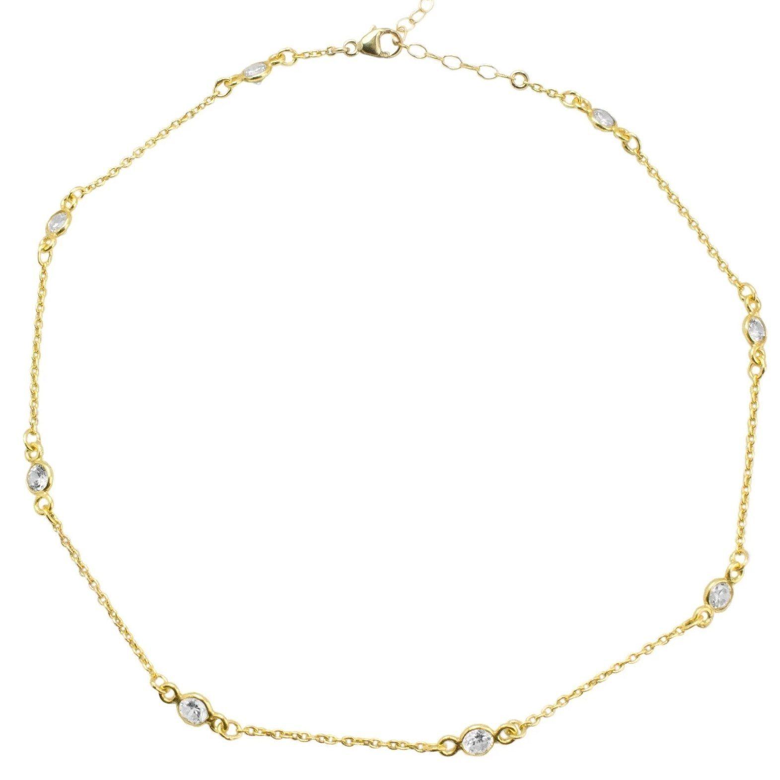 Up close image of gold Crystal Chain Choker against a white background.