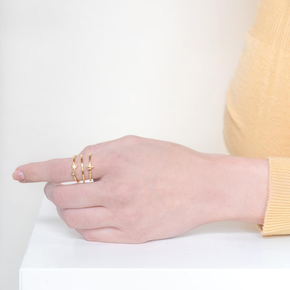 Image of models hand wearing the gold Desert Stack against a white background.