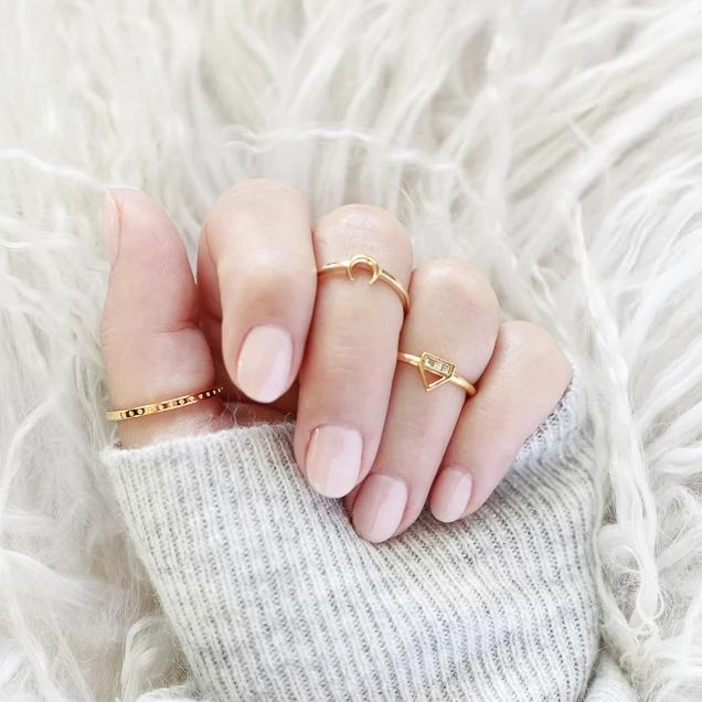 Image of models hand wearing the gold Moon Ring.