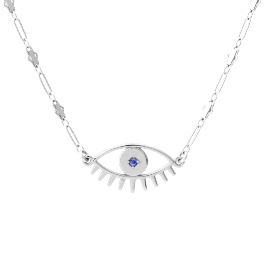 Up close image of the silver Evil Eye Necklace pendant with blue stone against white background.