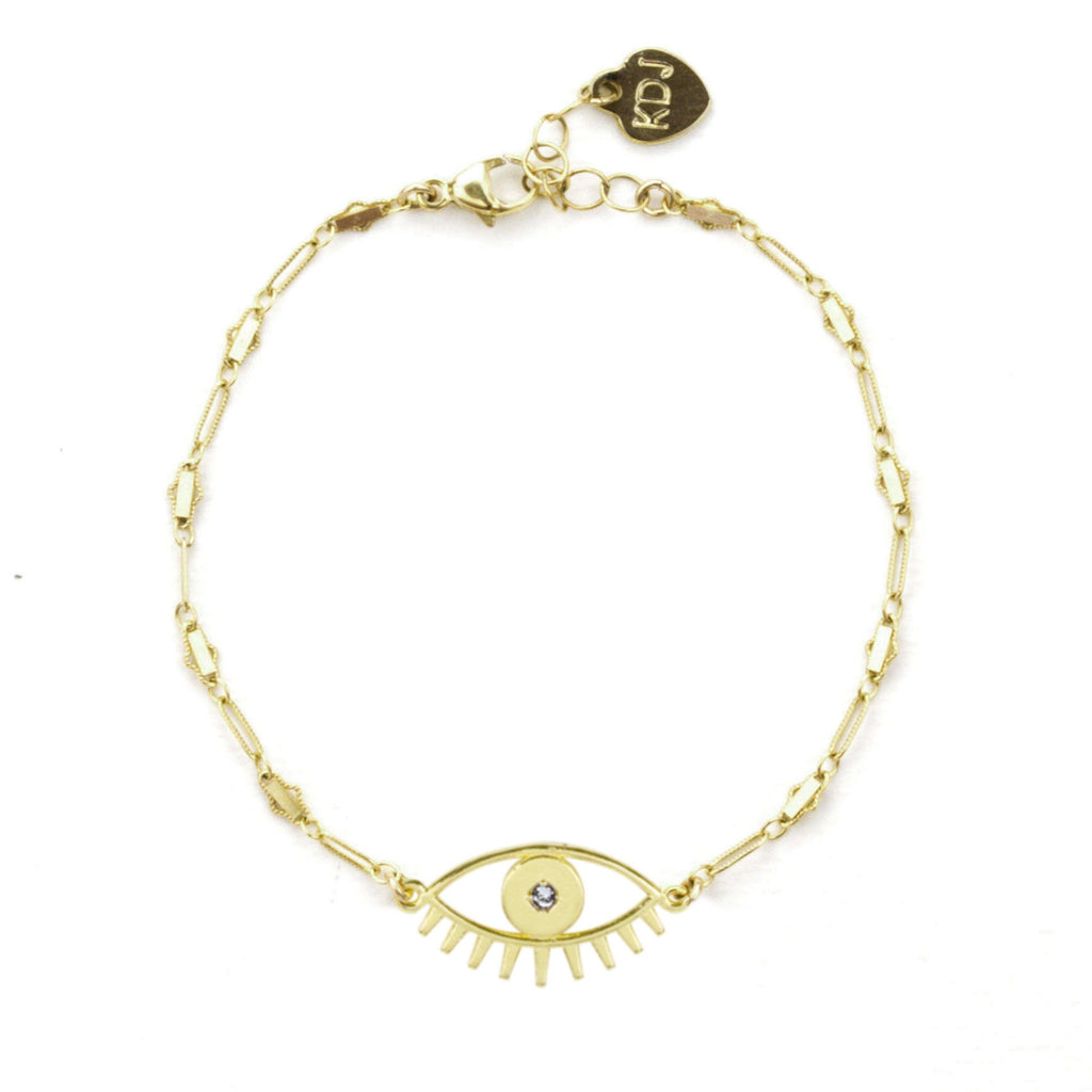 Gold Evil Eye Bracelet shown on a white background, by Katie Dean Jewelry.