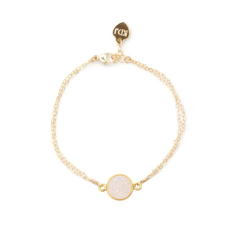 Up close image of the gold Fantasia Bracelet with round stone against a white background.