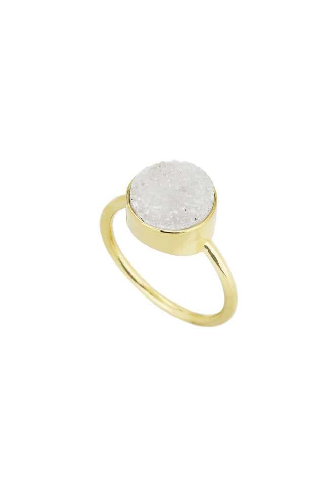 Up close image of the gold Fantasia Ring with a round white stone.