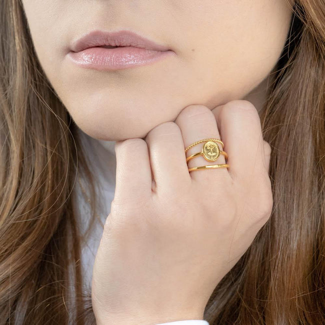 Up close image of model wearing the gold Floral Stack.
