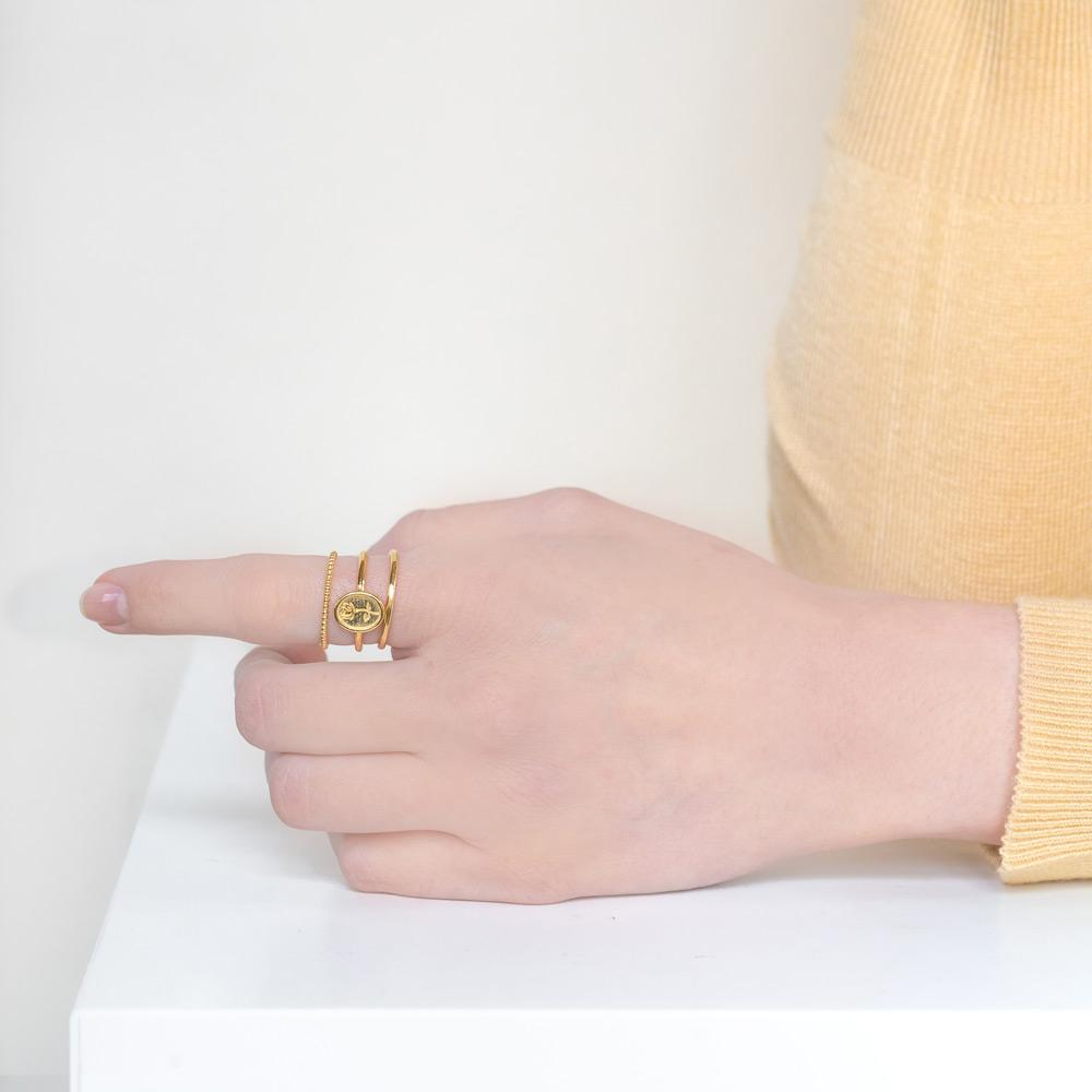 Image of models hand wearing the gold Floral Stack against a white background.