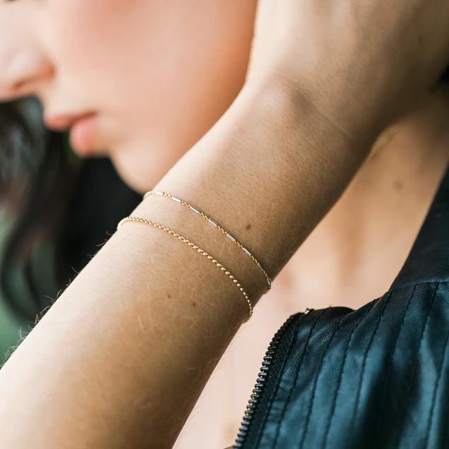 Up close image of model wearing the Silver and Gold Bracelet.