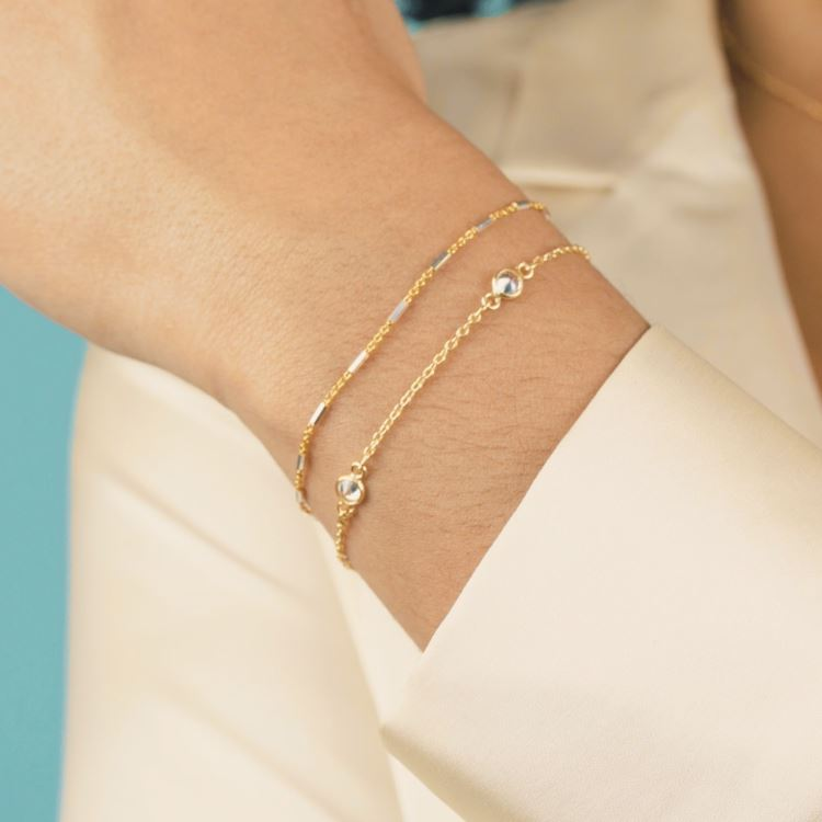 Golden Bracelet Set shown on a hand model, handmade by Katie Dean Jewelry.