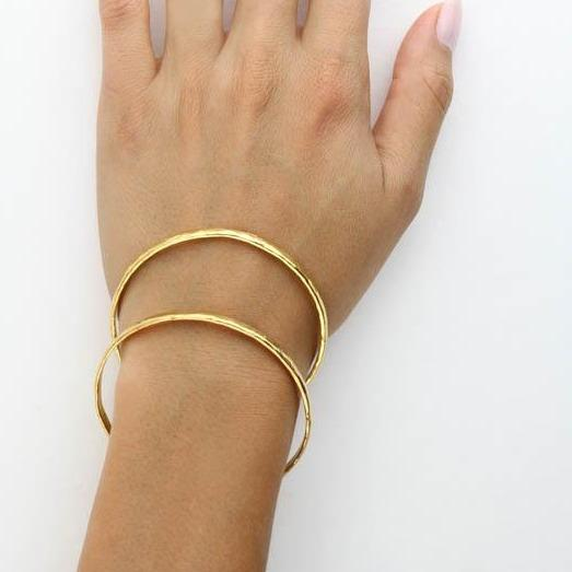 Image of models hand wearing the gold Hammered Bangle.