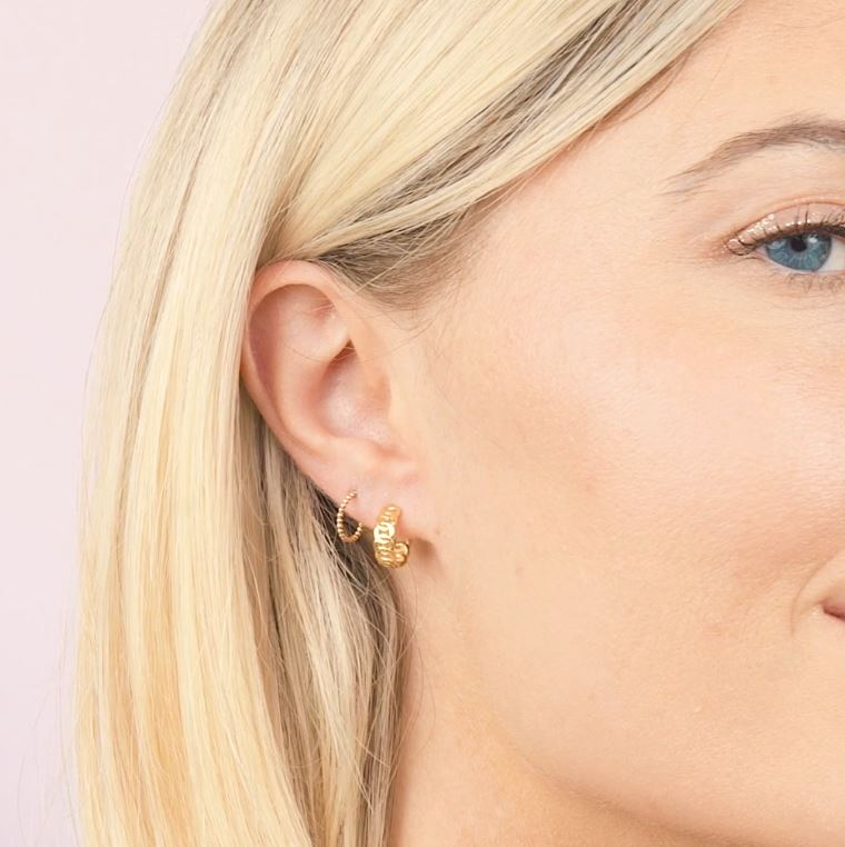 Hoop there it is. We're obsessed with these perfectly sized hoop huggie stud earrings. The only thing that could make it is getting them as a set. So make it official! Nickel free and hypoallergenic. Handmade in California by Katie Dean Jewelry.