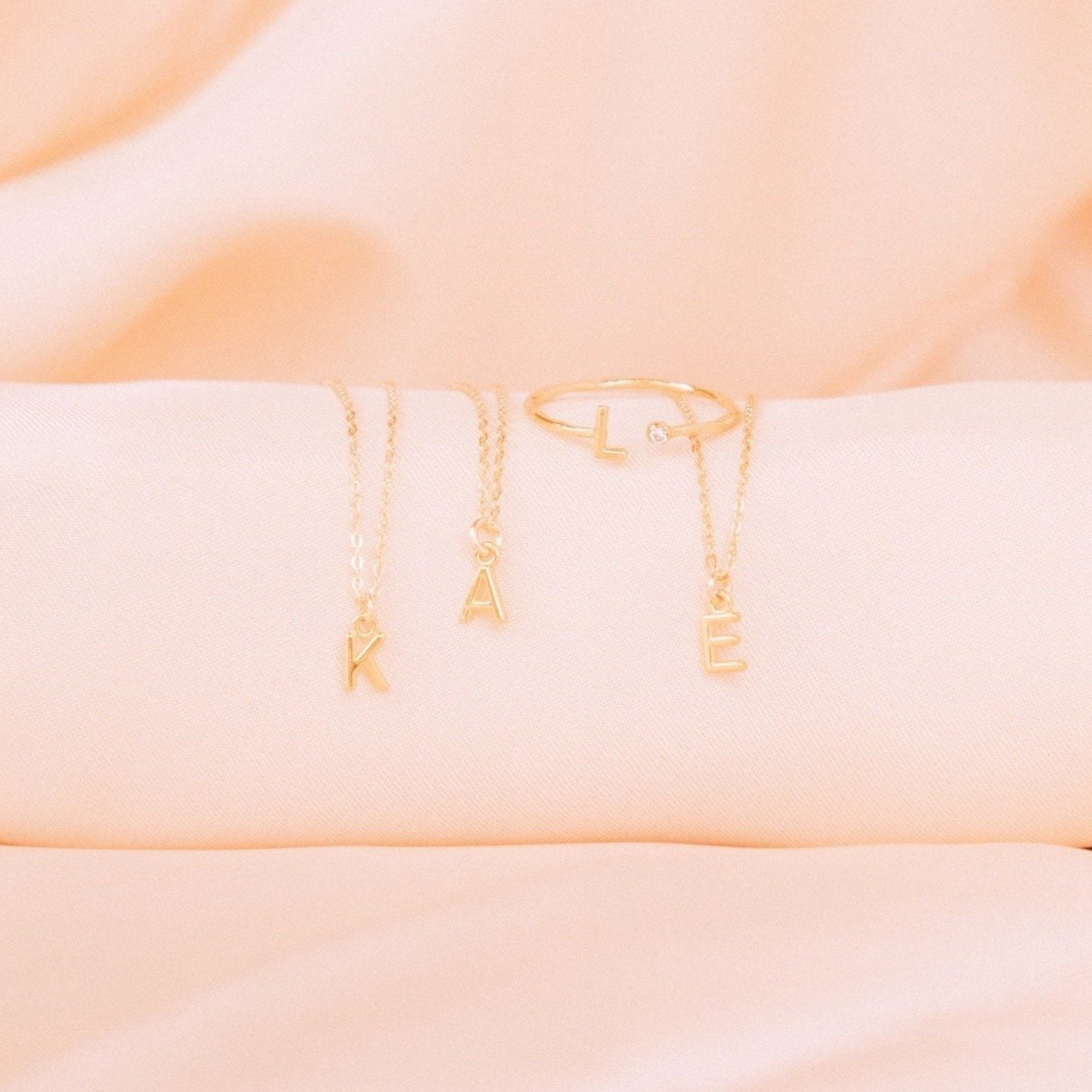 Initial Necklaces on pink satin, Initials K A E, made by Katie Dean Jewelry