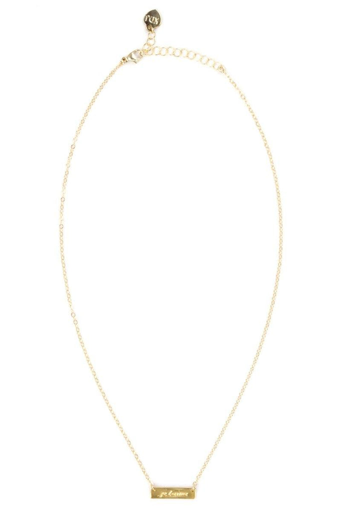 Up close image of the gold Je Taime Necklace against a white background.