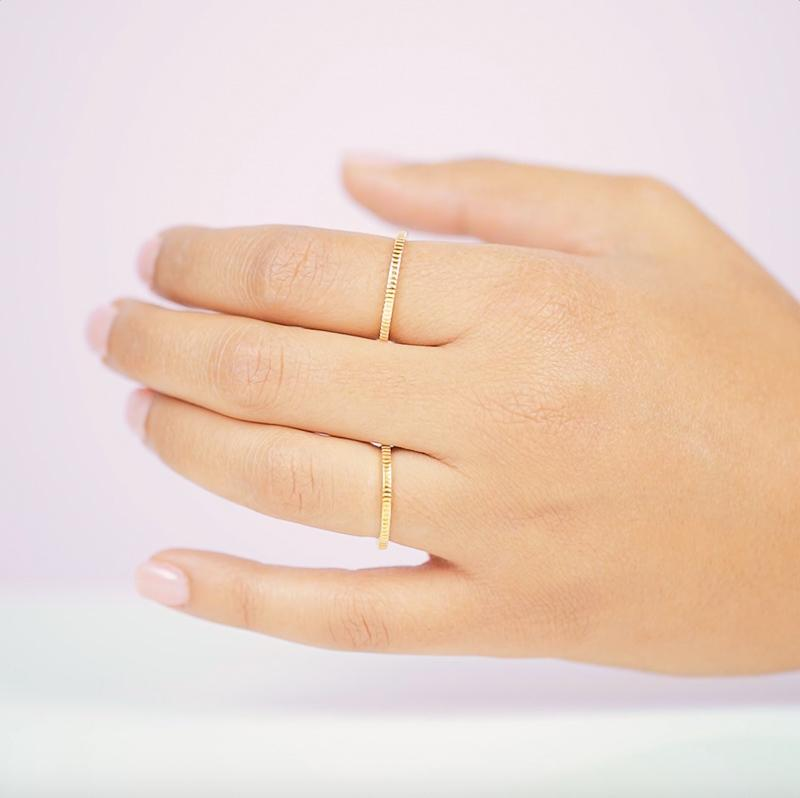Putting a twist on the classic band ring with some intricate coin details. Perfect for your next stacking ring.