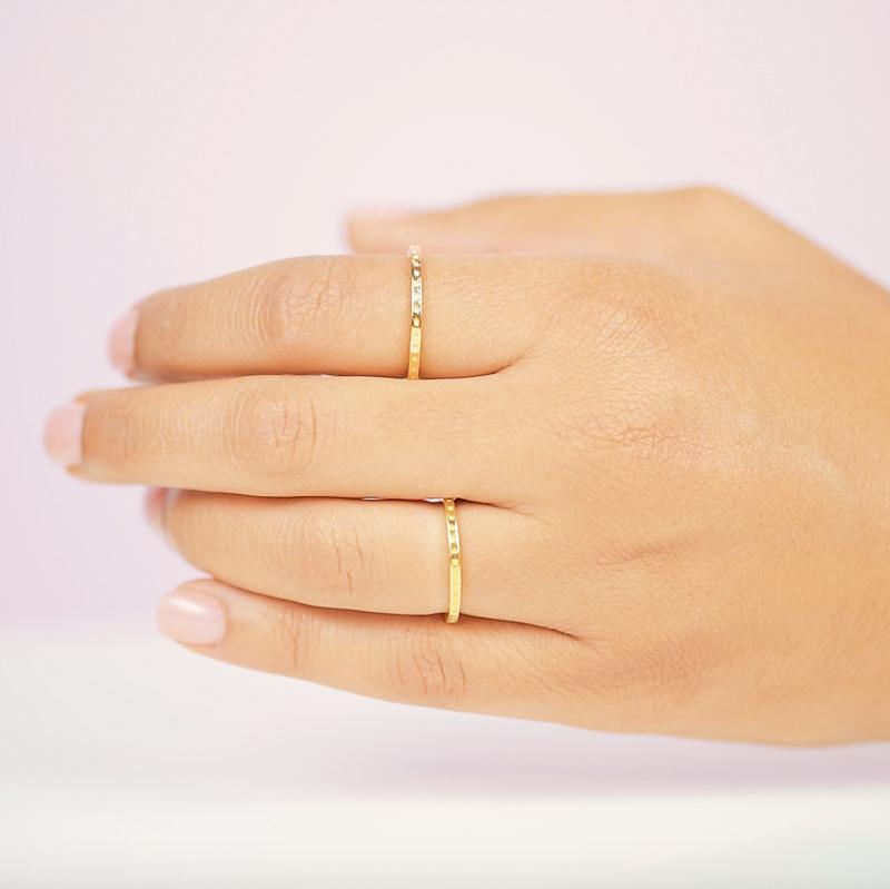 A lovely stacking ring, the Dotted Ring is perfect for the minimalist who wants to add a little texture to their ring look. Handmade in California by Katie Dean Jewelry.