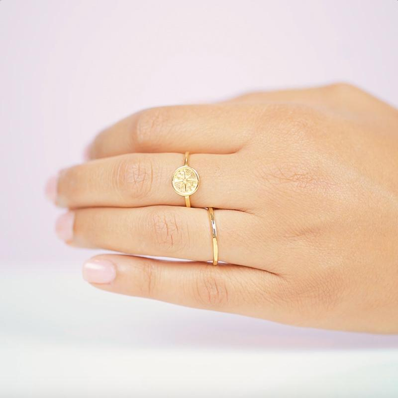 The Eight Pointed Star Ring helps guide you through life, just like a compass on a dark night at sea. Handmade in California by Katie Dean Jewelry.