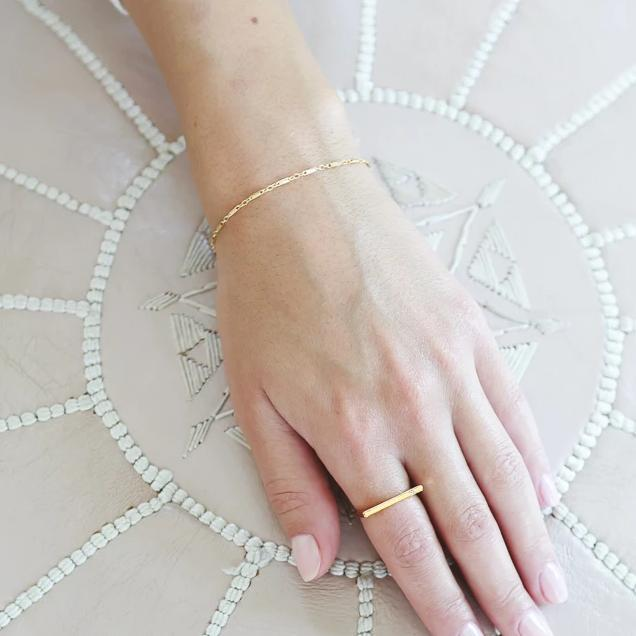 Image of models hand wearing the gold Linked Bracelet.