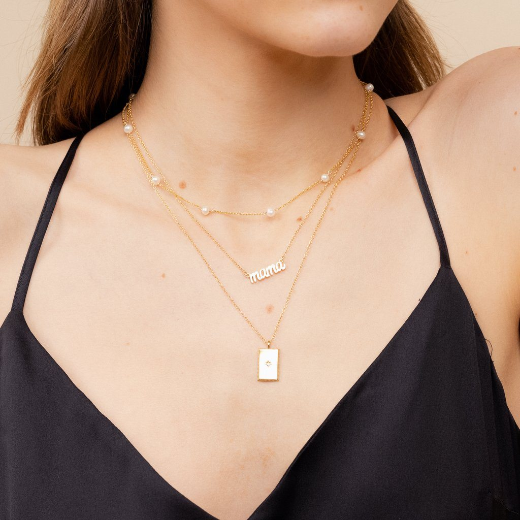 Dainty gold Mama Necklace layered with the Pearl Choker, and Rectangle Necklace by Katie Dean Jewelry