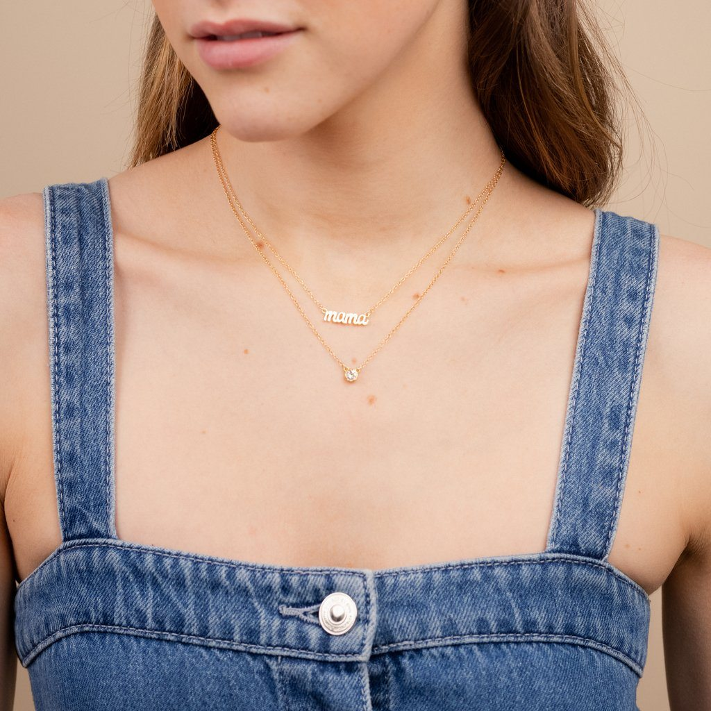 Dainty gold Mama Necklace layered with the April Birthstone Necklace by Katie Dean Jewelry