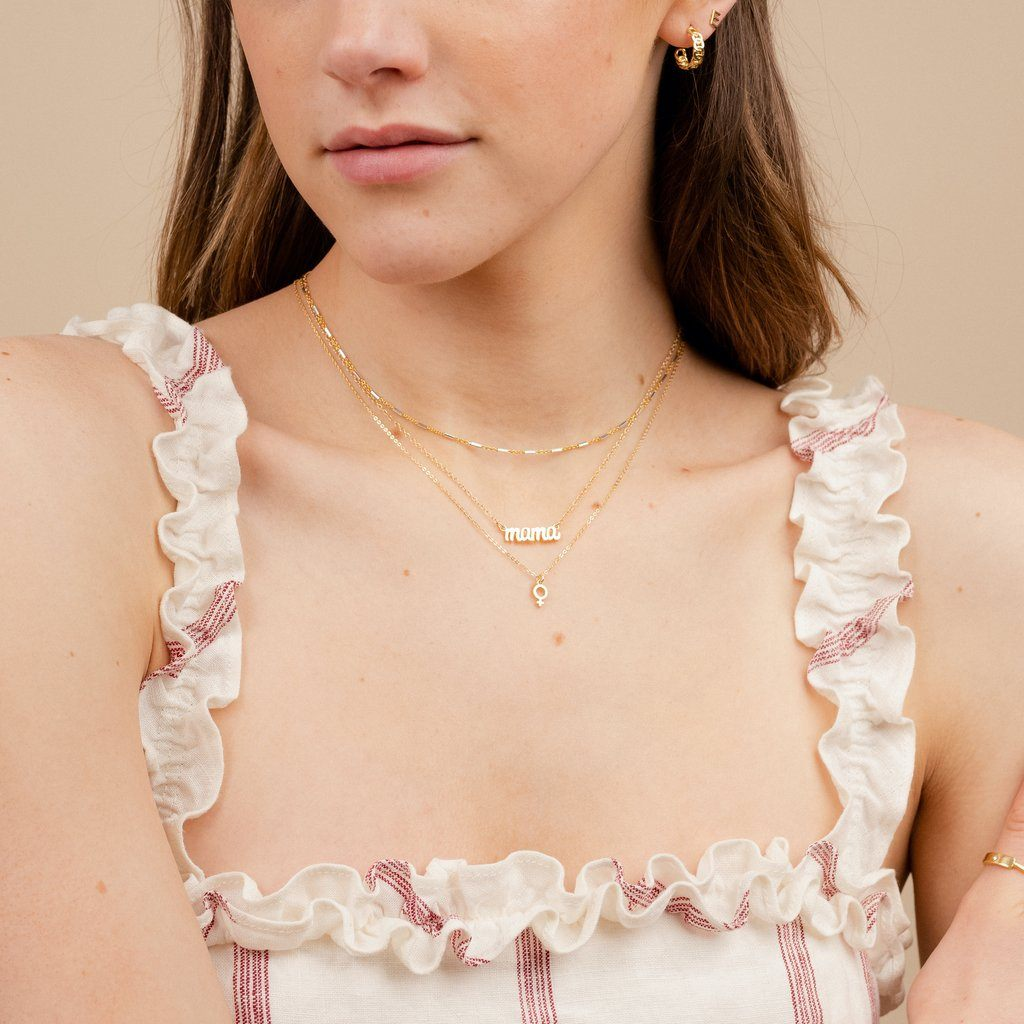 Dainty gold Mama Necklace layered with the Silver and gold Choker, and the Female Symbol Necklace by Katie Dean Jewelry