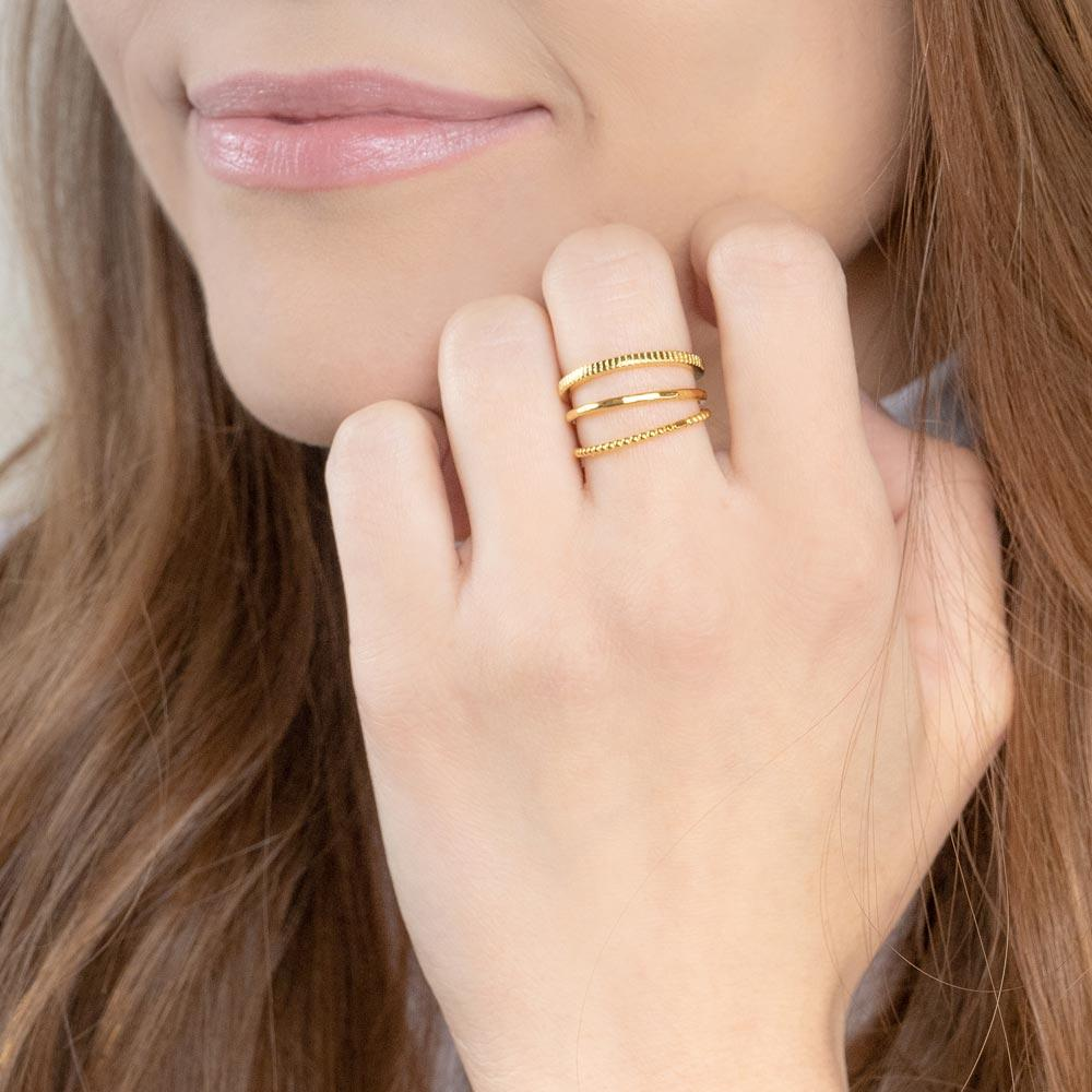 Up close image of model wearing the gold Minimal Stack.