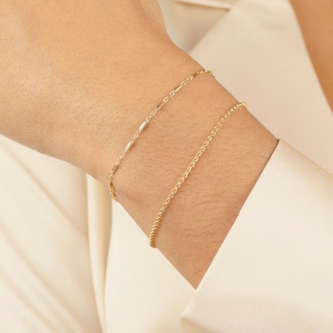 The Minimal Bracelet Set as shown on a hand model, handmade in California by Katie Dean Jewelry.