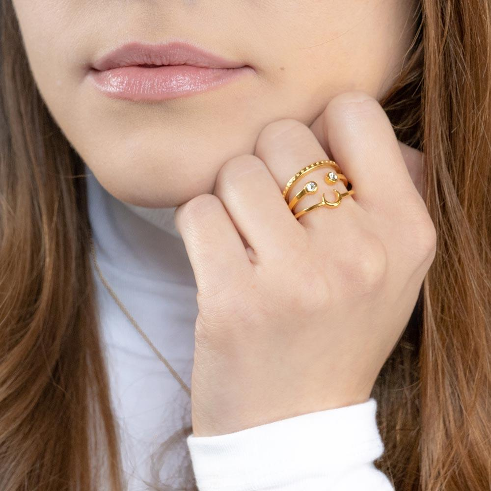 Up close image of model wearing the gold Moon Stack.