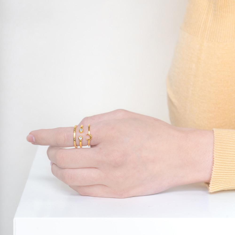Image of models hand wearing the gold Moon Stack against a white background.
