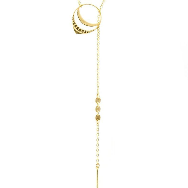 Up close image of the gold Needle & Thread Lariat pendant and chain.