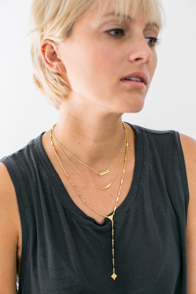 Katie Dean model wearing the gold Mi Amor Necklace.