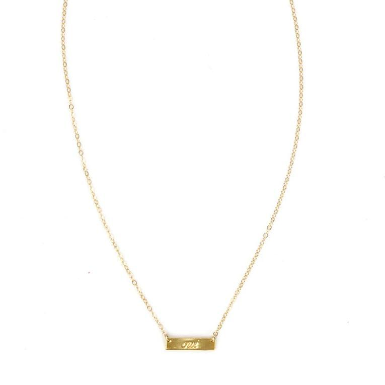 Image of the gold Oui Necklace against a white background.