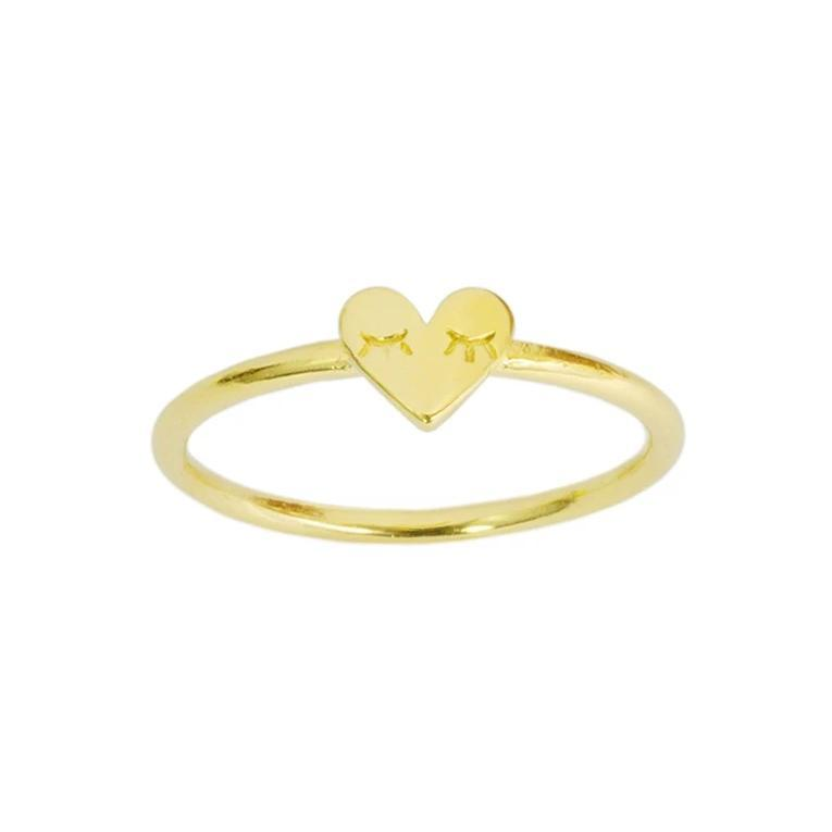 Up close image of the gold Heart Ring against a white background.