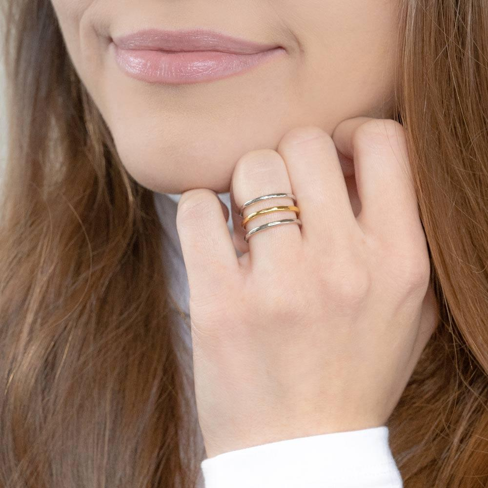 Up close image of model wearing the Silver & Gold Stack.
