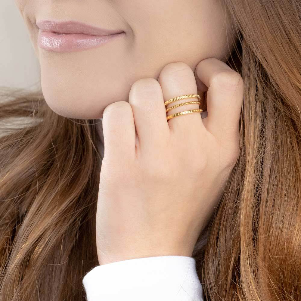 Up close image of model wearing the gold Simple Stack.