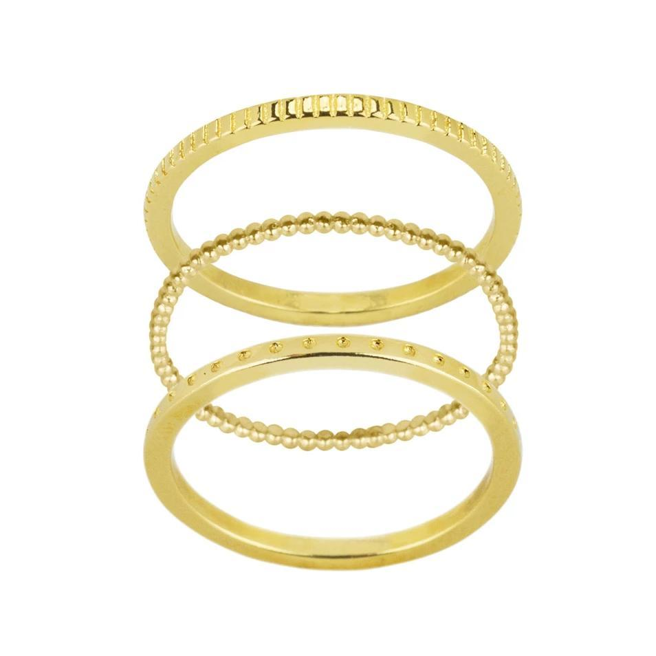 Up close image of the gold Simple Stack with the Coin Ring on top, the Beaded Ring in the middle & the Dotted Ring on the bottom.
